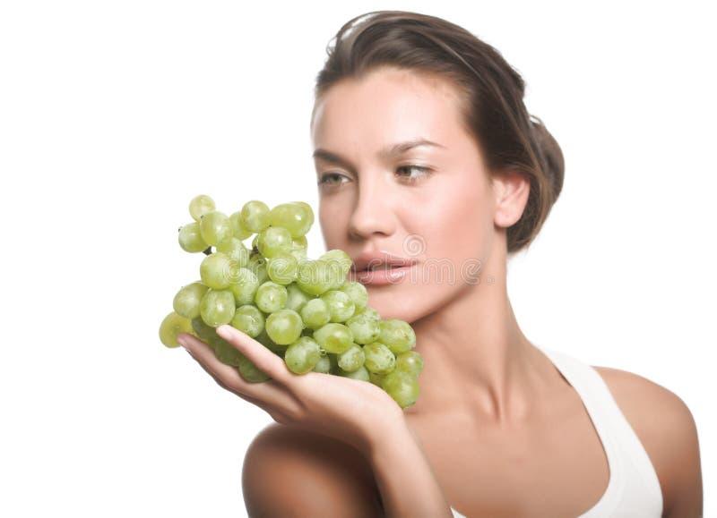 Girl with grape stock image