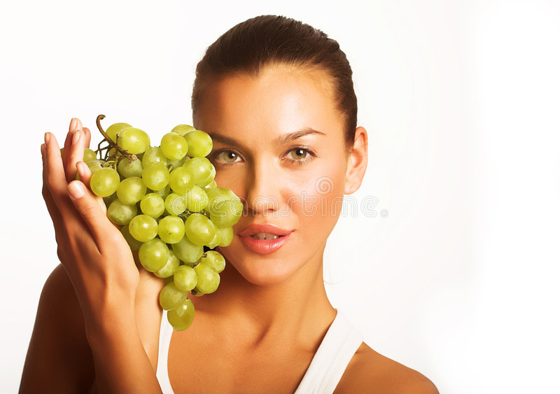 Girl with grape stock photography