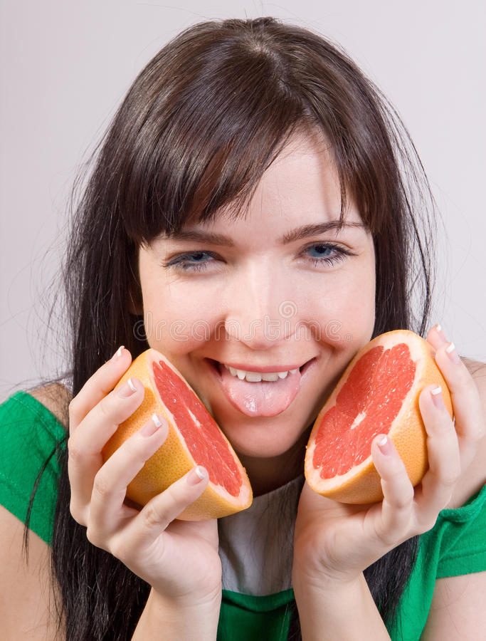 Download Girl With Grapefruit Royalty Free Stock Photos - Image: 20556218