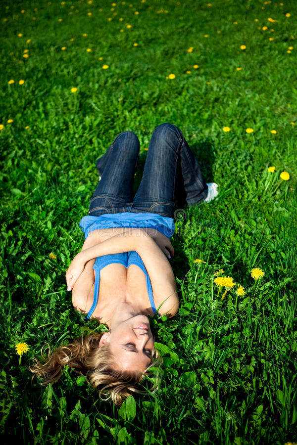 Girl in grass royalty free stock images