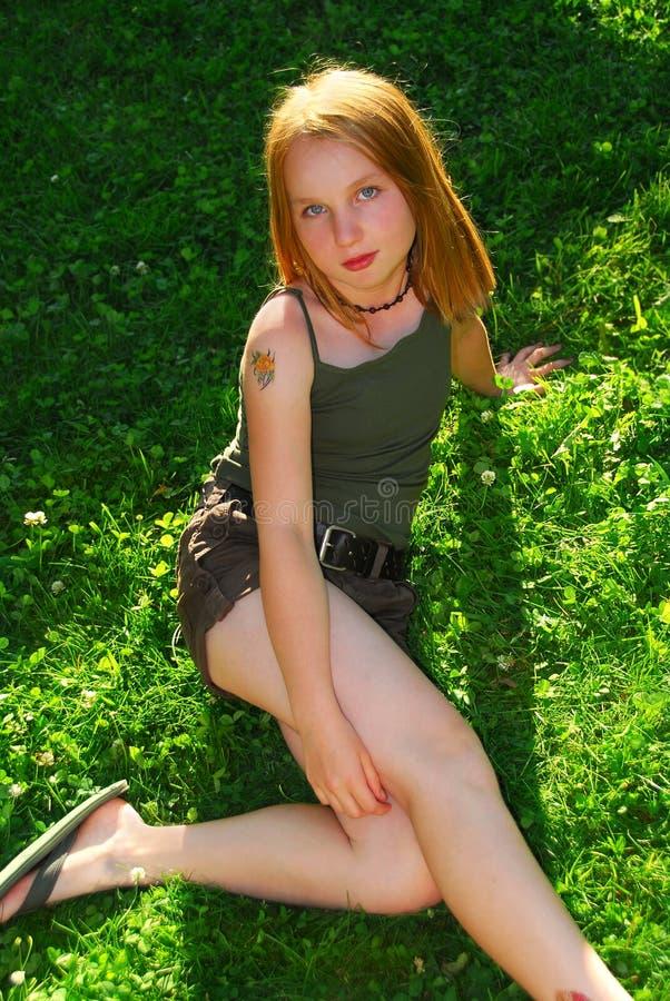 Girl grass royalty free stock image