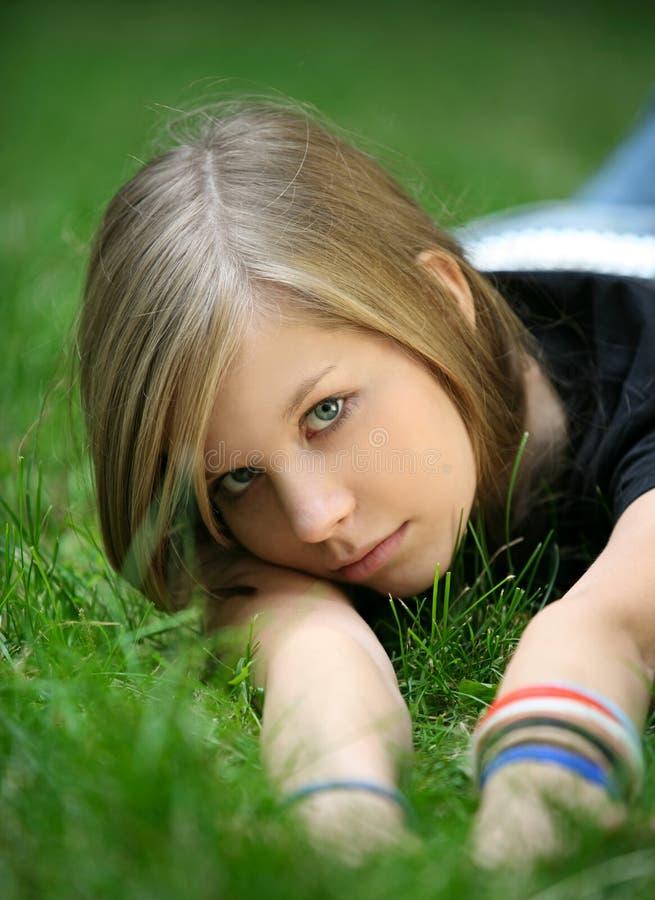 Girl in a grass royalty free stock photos