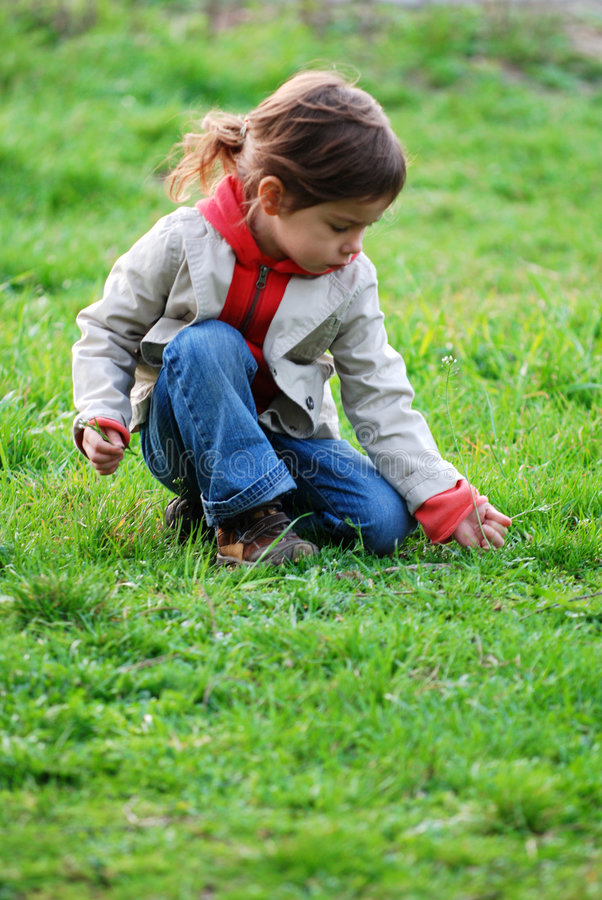 Girl on grass royalty free stock photos