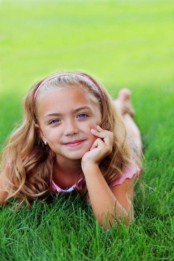 Girl in the Grass royalty free stock images