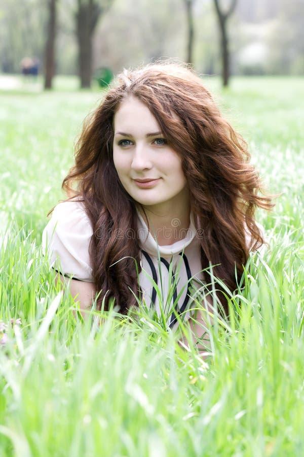 Girl on grass royalty free stock photos