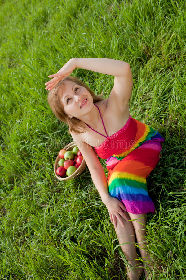 Download Girl On The Grass Next To A Basket Of Apples Stock Photo - Image: 20667072