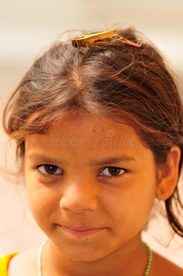 Girl with grasshopper royalty free stock photos
