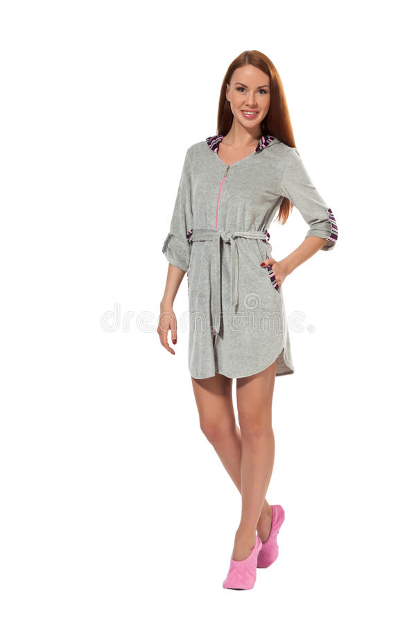 A girl in a gray bathrobe royalty free stock photography