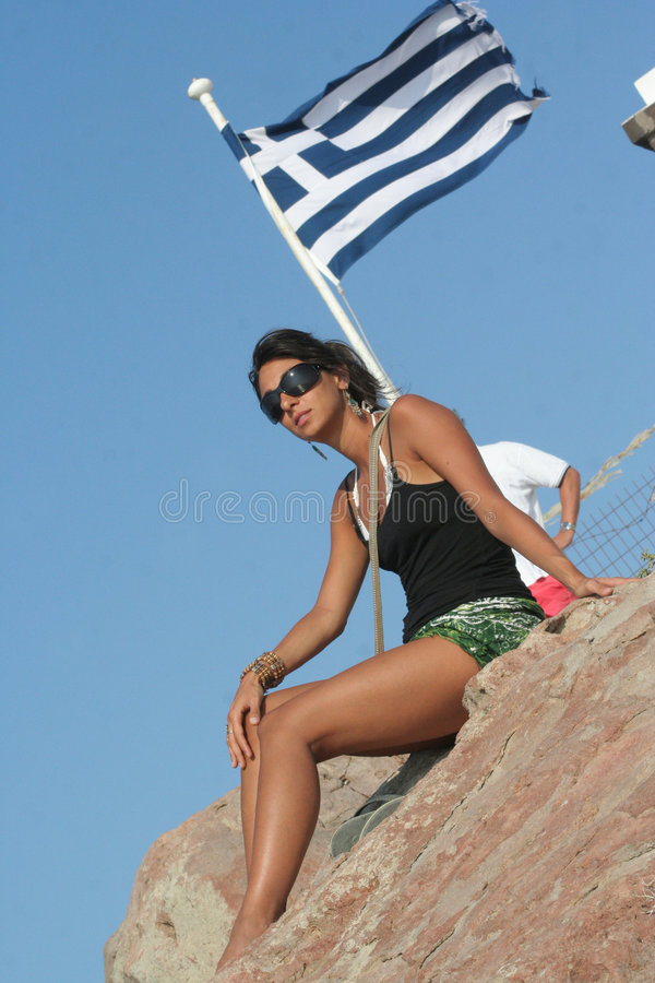 Girl and the greek flag stock photo