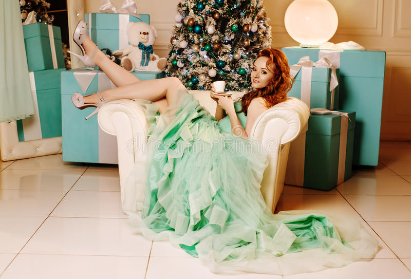 Download Girl In Green Dress With Christmas Tree Stock Photo - Image: 83714903
