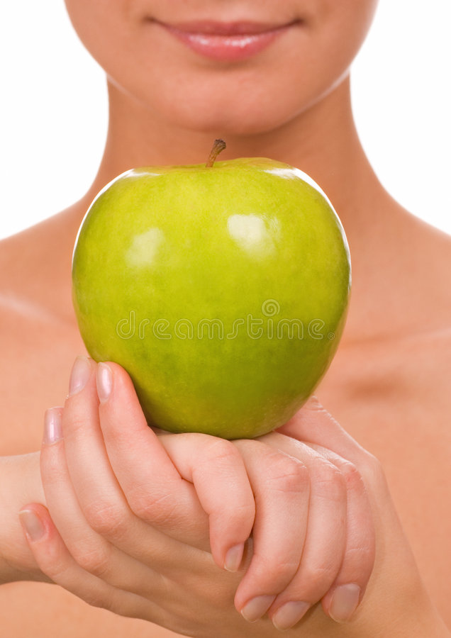 Girl with a green juicy apple stock photos