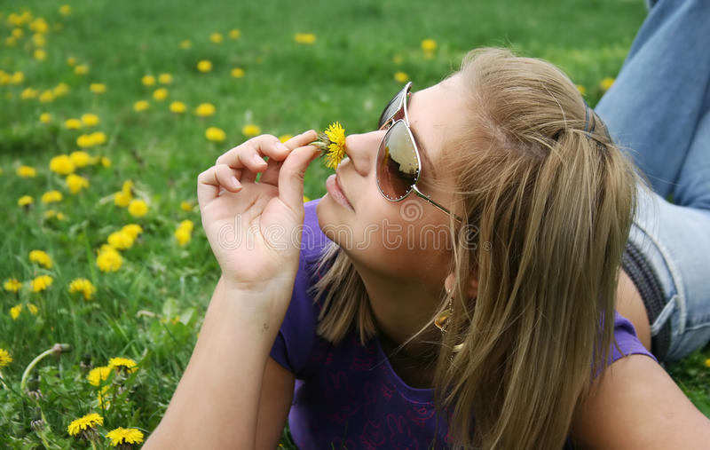 Girl and green meadow royalty free stock images