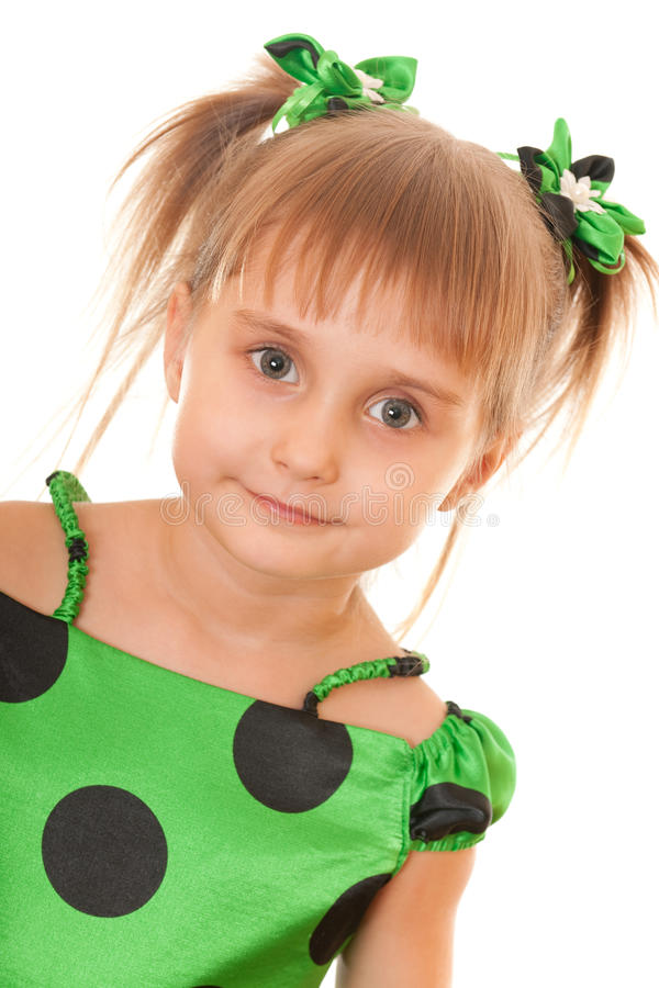 Girl in green polka dot dress. A portrait of a cheerful girl in green polka dot dress; isolated on the white background stock photo