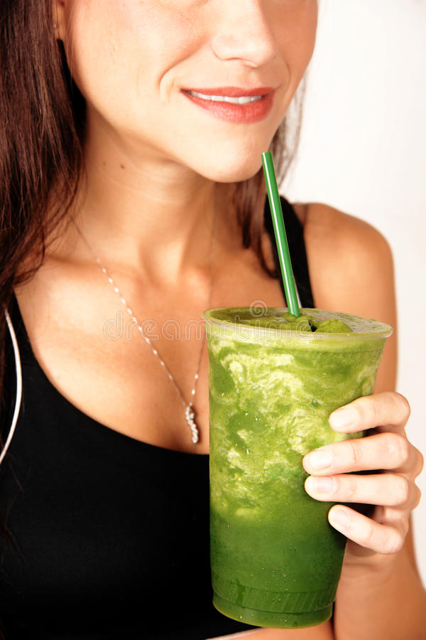 Girl Holds Green Fruit Food Smoothie Smiling royalty free stock photo