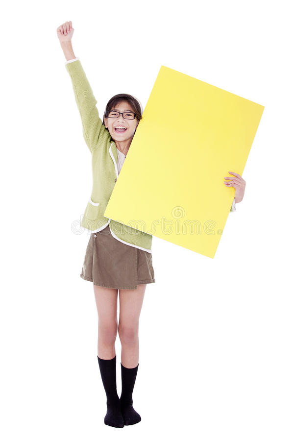 Girl in green sweater holidng blank yellow sign, arm cheering in stock photo