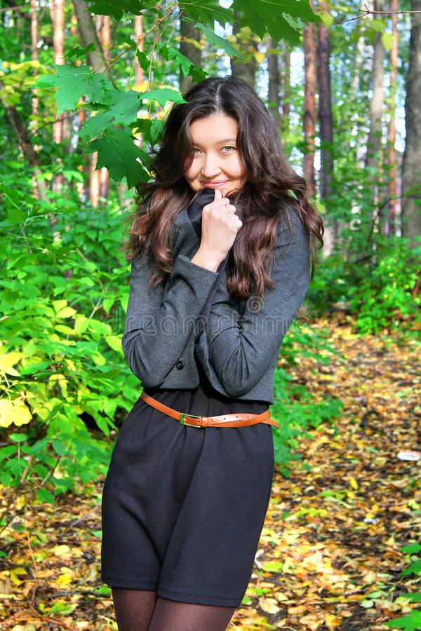 Girl In A Green Wood Stock Photography
