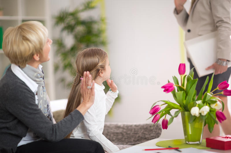 Girl greeting her mother and stay at home with her grandmother. Gesture, happiness, generation, home and people concept royalty free stock photos
