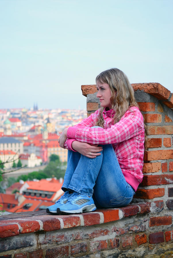 The girl with grief looks at a city royalty free stock photos