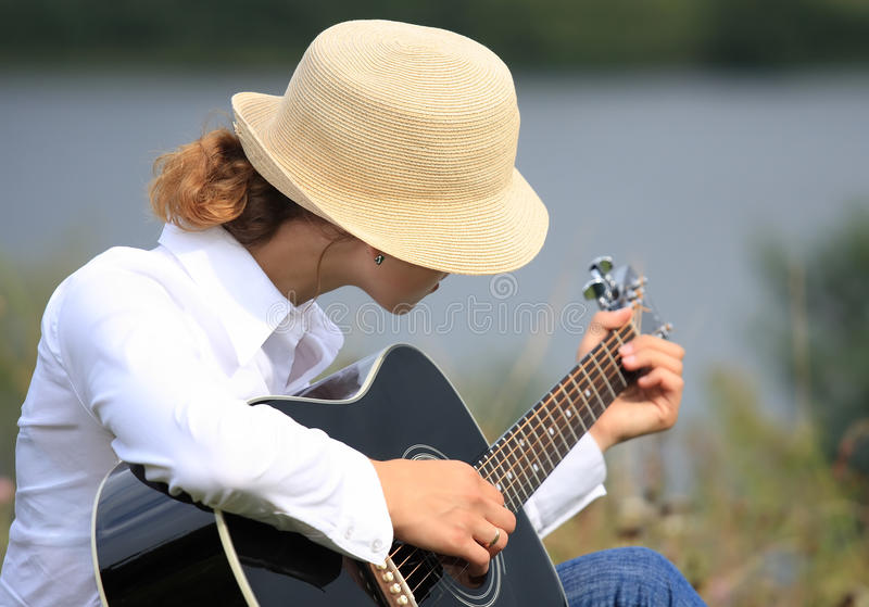 Girl with the guitar stock images