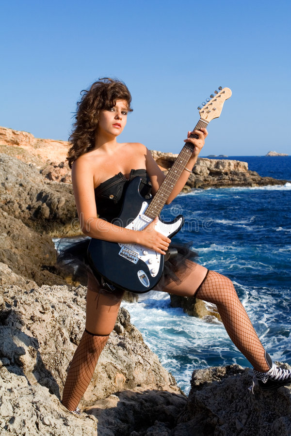 Girl with guitar royalty free stock images