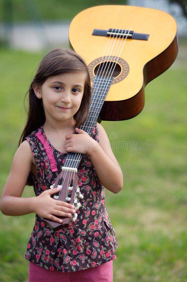 Girl with a guitar stock photo