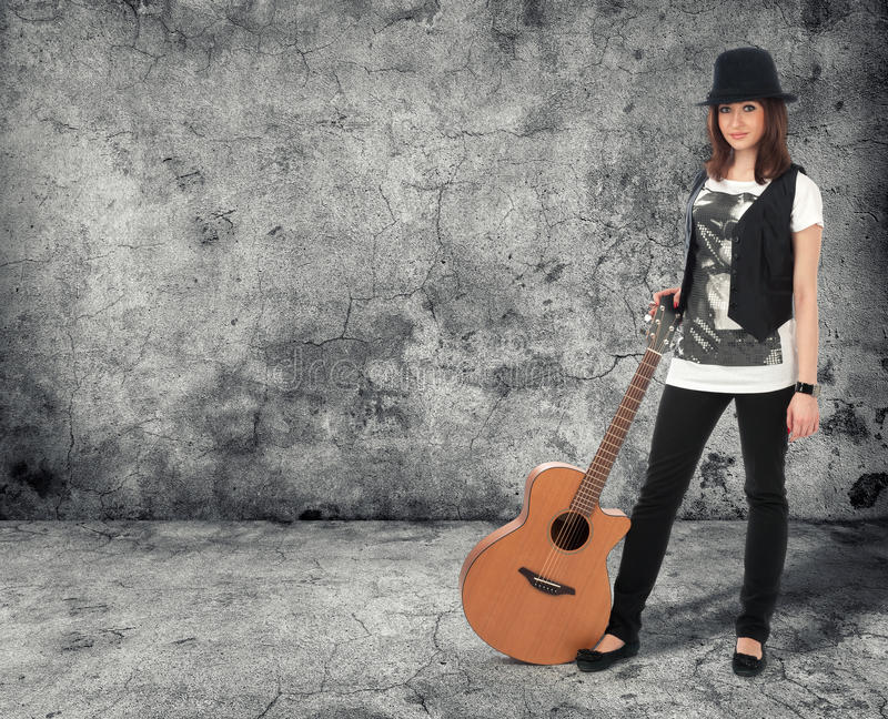 Girl with the guitar royalty free stock photography