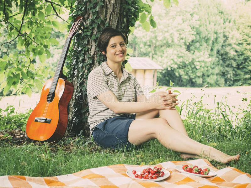 Girl and guitar in vintage color royalty free stock image