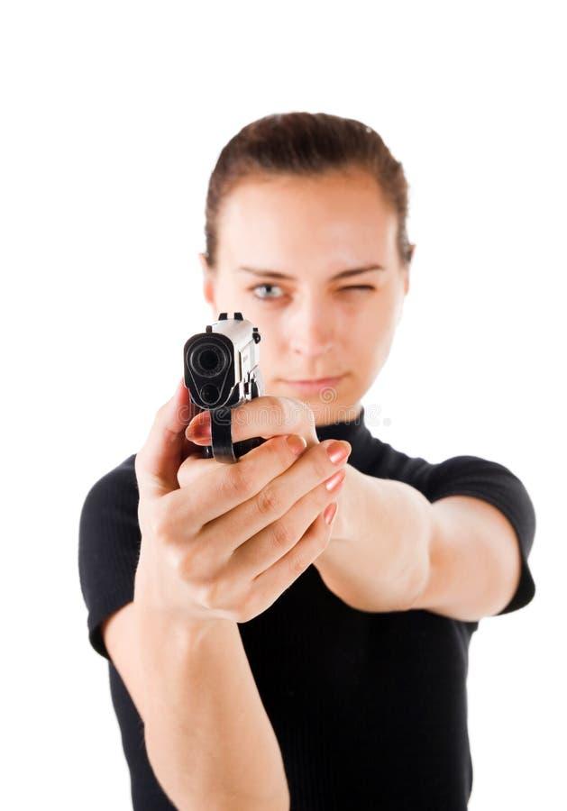 Girl with gun. stock image