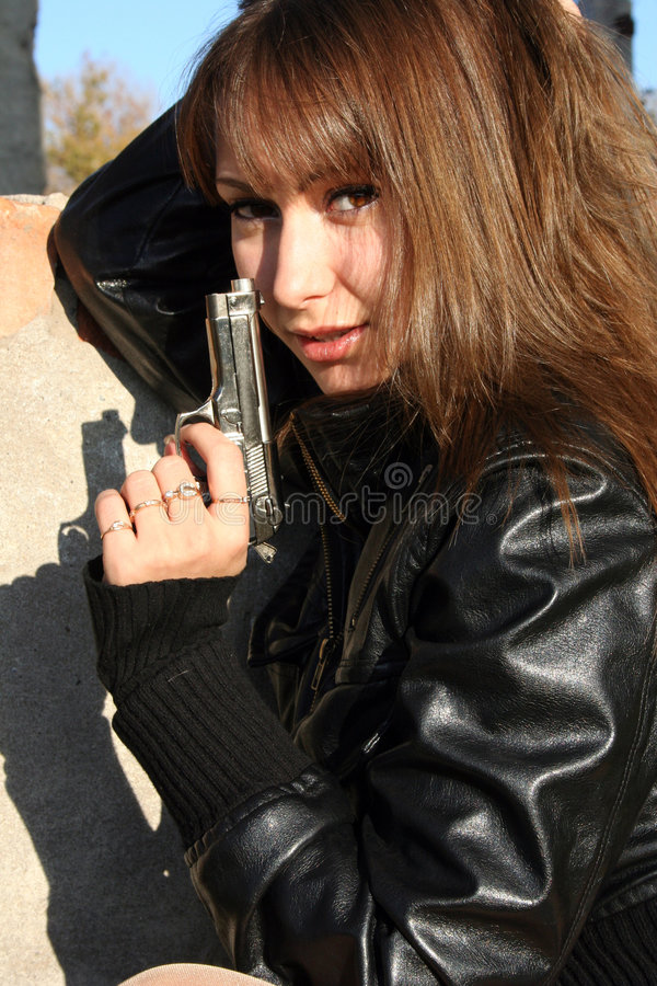 Download Girl with gun stock photo. Image of military, pistol, charming - 7413588