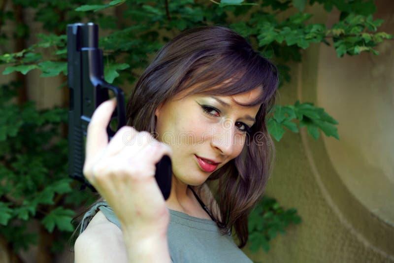 Girl with Gun royalty free stock photos
