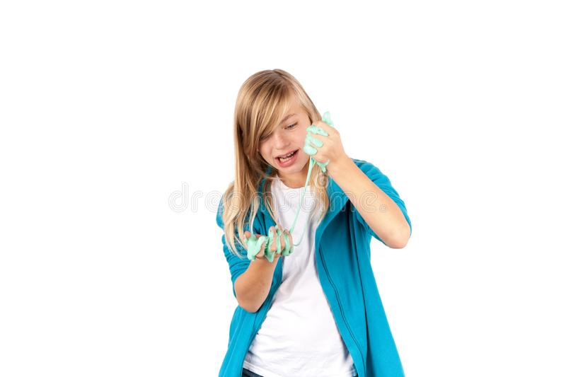 Girl with gunk-like green slime. Isolated on white background. royalty free stock photography