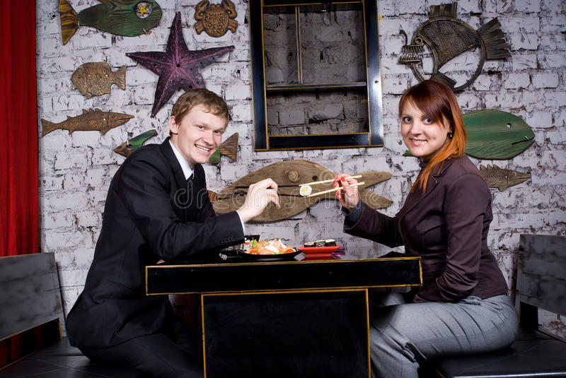 Girl With A Guy Eating A Sushi Restaurant Stock Photography