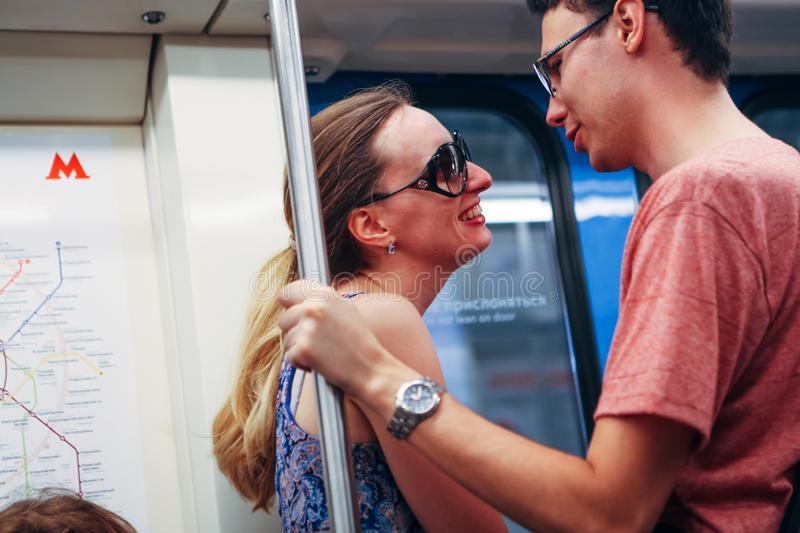 Girl and guy stand in the subway royalty free stock images