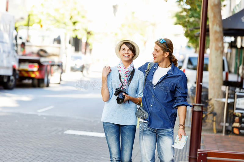 Girl and guy on the streets of a city royalty free stock image