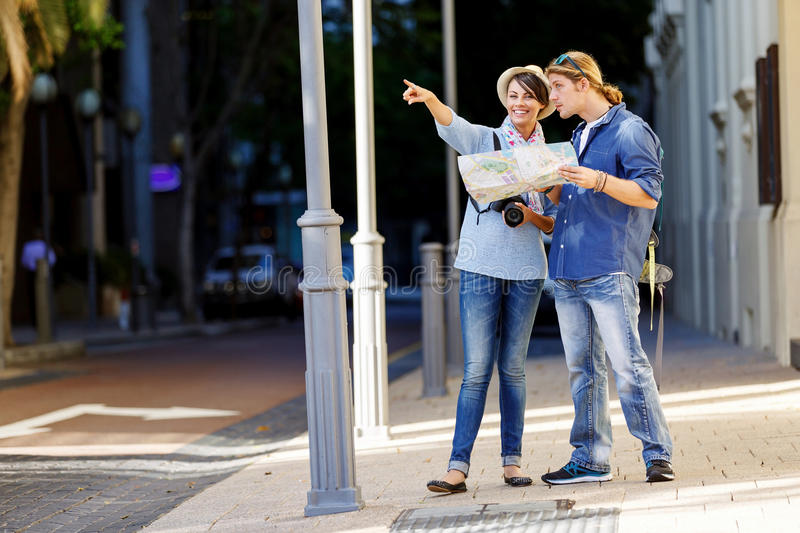 Girl and guy on the streets of a city stock images