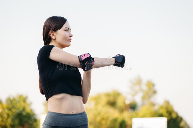 Girl gym in the park. Fitness in nature. Morning exercise with beautiful, sport woman royalty free stock photo