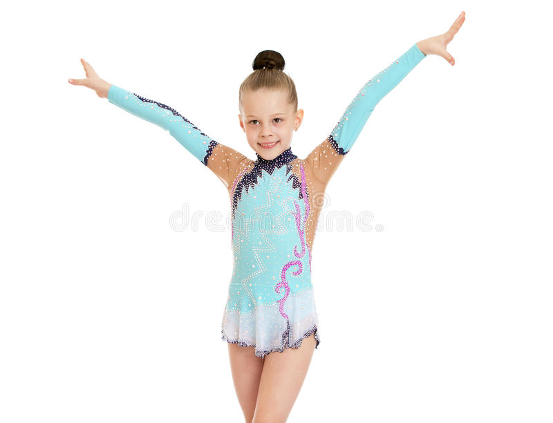 Girl gymnast. Beautiful slender little girl gymnast in the sport bathing suit does exercises-Isolated on white background stock photo