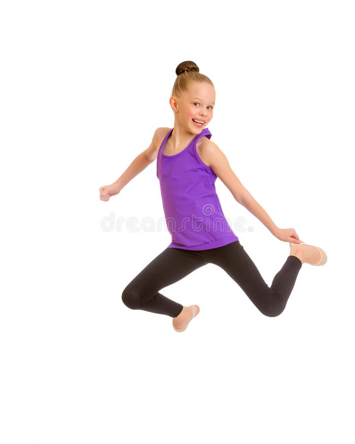 Girl gymnast jumping. stock photos