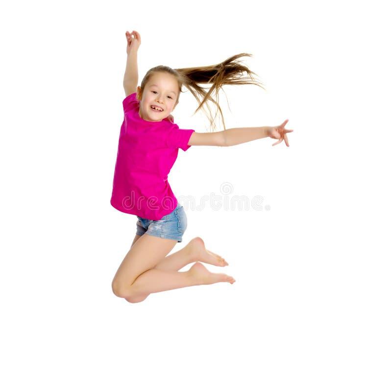 Girl gymnast jumping. stock photos