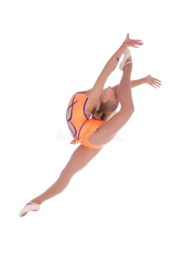 Girl gymnast jumping royalty free stock image