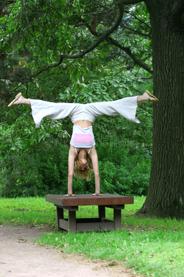 Girl gymnast in park stock images