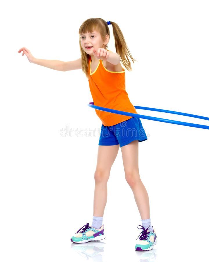 A girl gymnast performs an exercise with a hoop. stock photos