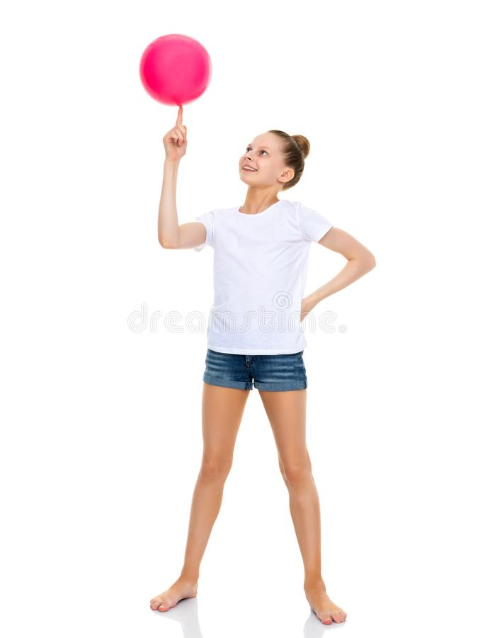 Girl gymnast performs exercises with the ball. royalty free stock images