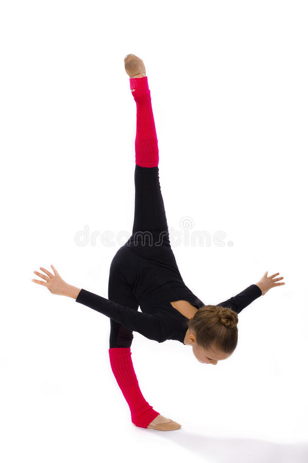 Girl gymnast on a white background. Girl does exercises of rhythmic gymnastics on a white background stock photography