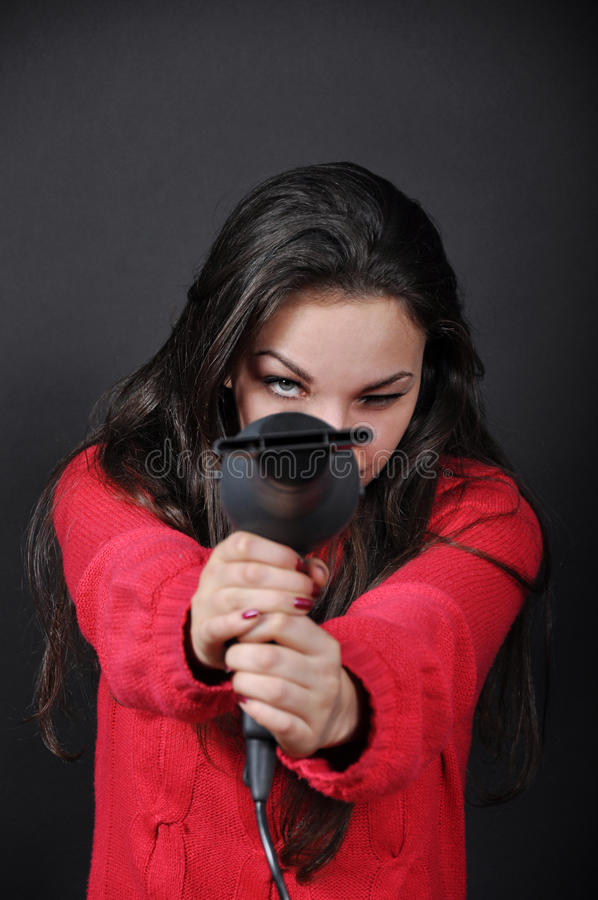 Girl with a hair dryer royalty free stock photo