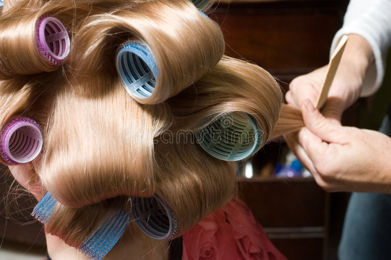 Girl in Hair Rollers stock image
