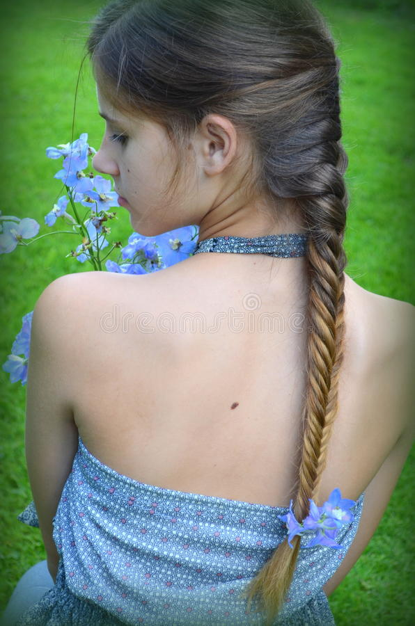 Girl with hairstyle fishtail stock image