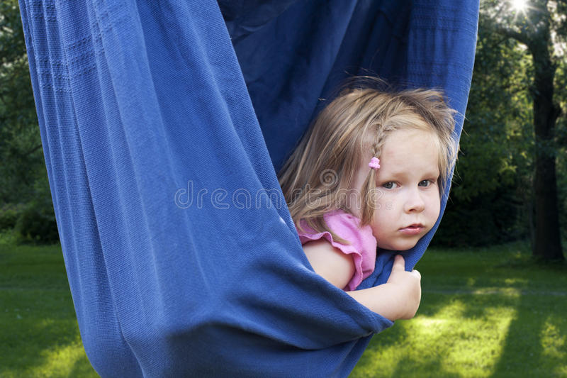 Girl in hammock. Little girl relaxing in hammock stock photos