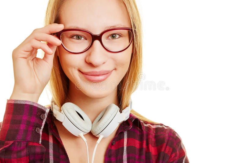 Girl with hand on her glasses royalty free stock photo