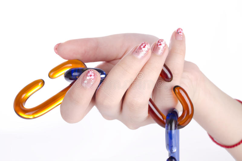 Girl hand holding glass chains royalty free stock photos